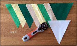 Na každú vlajočku striháme 2 trojuholníky látky
